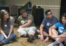 team-listening-sitting-on-floor